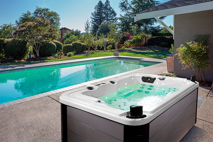 Stand-Alone in-ground Jacuzzi next to Pool.